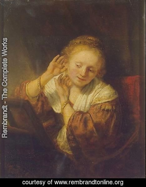 Rembrandt - A Young Woman Trying on Earings