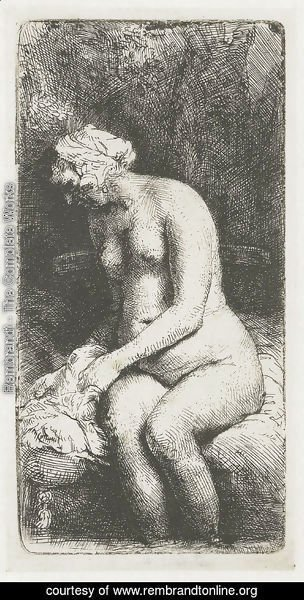 Rembrandt - A Woman bathing her Feet at a Brook