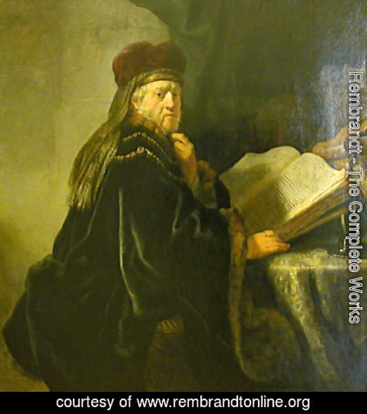 Rembrandt - A Scholar Seated at a Table with Books
